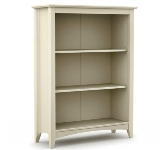 White bookcases and shelving units.